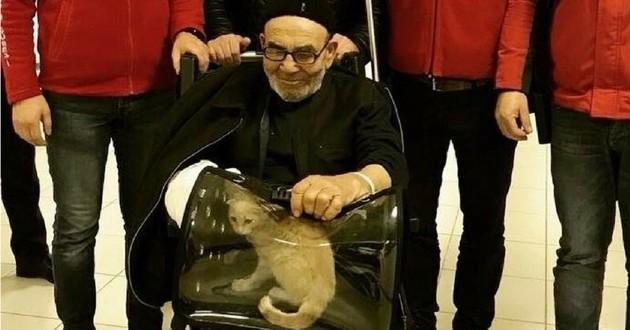 vieil homme chat incendie