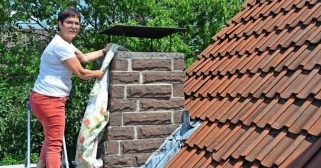 femme grimpe cheminée