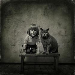 un chat, une petite fille, une belle amitié