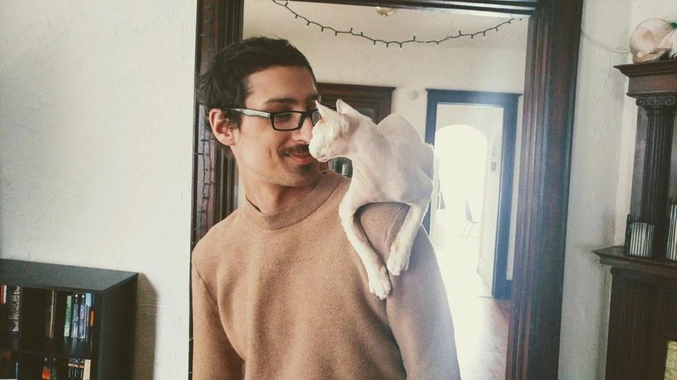 chat aveugle avec son maître